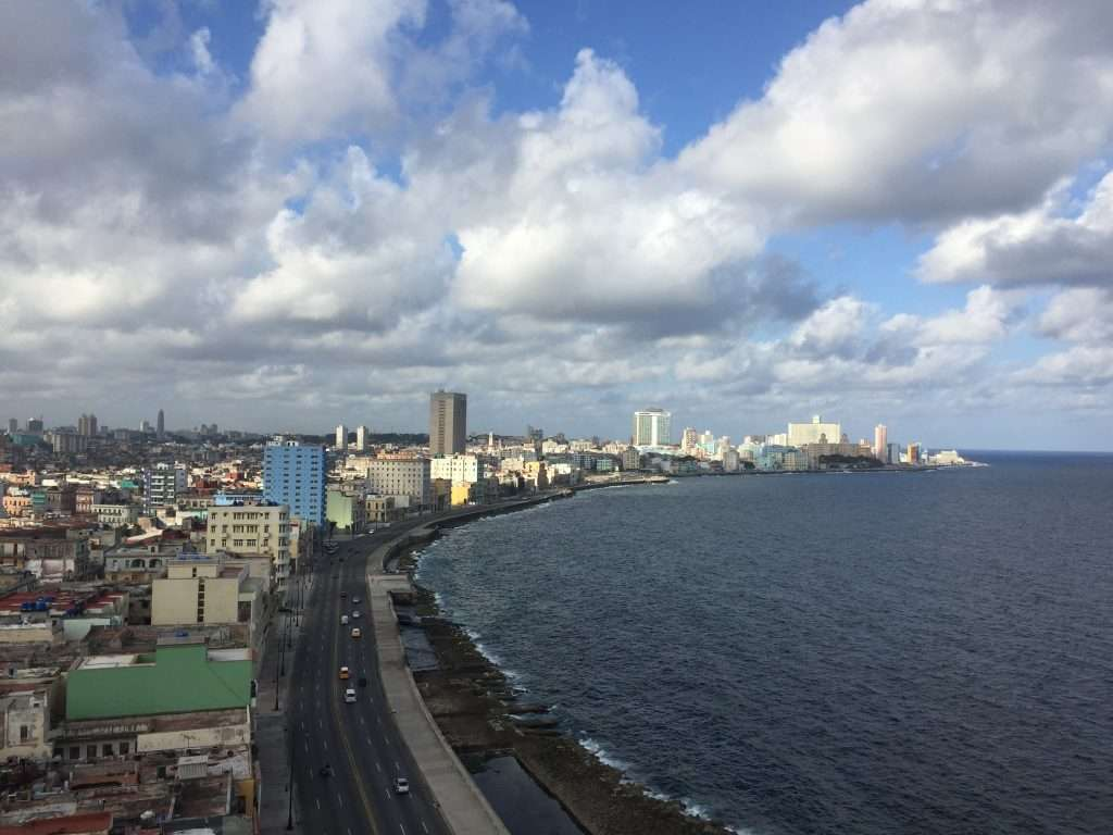 Gorgeous afternoon clouds over the Malecon in Havana, Cuba by Ralph Velasco