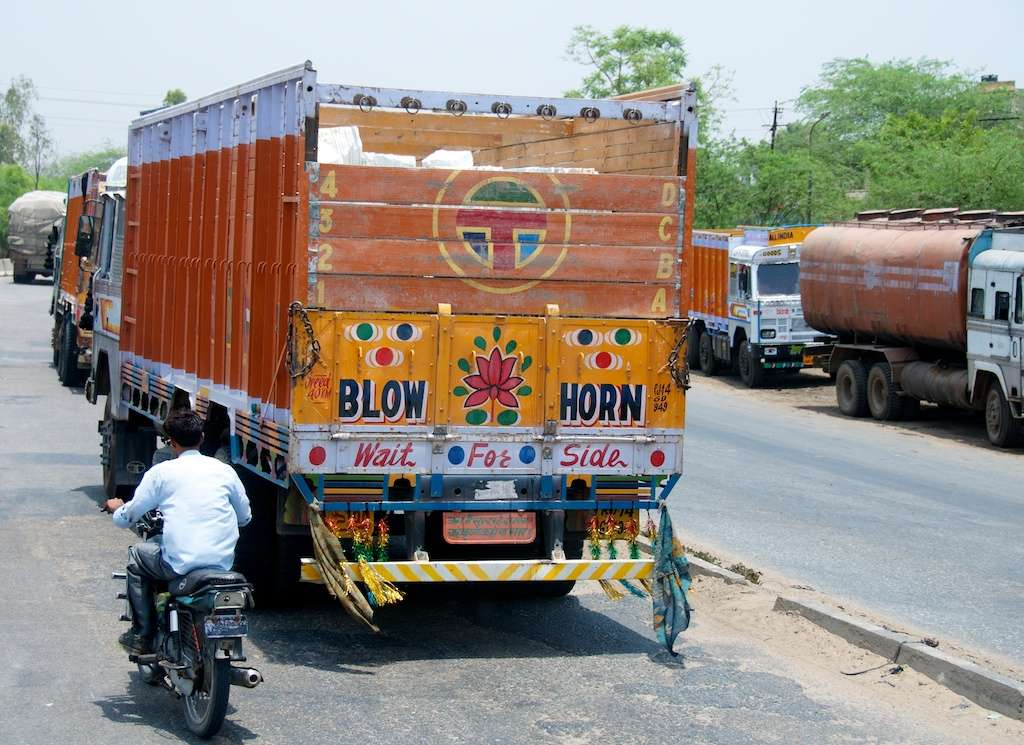 Blow horn on back of truck in Jaipur, India by Ralph Velasco