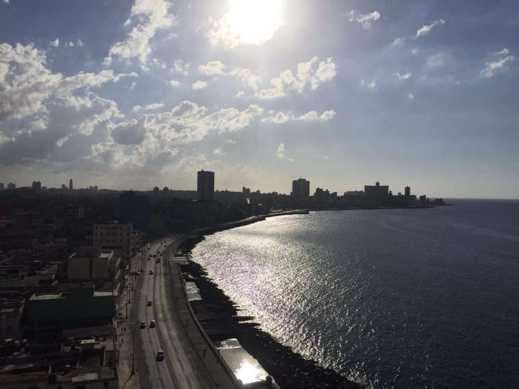 Late afternoon clouds and sun over the Malecon in Havana, Cuba by Ralph Velasco