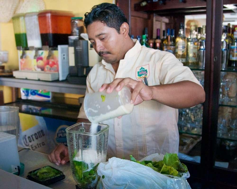 Man Preparing Chaya in Merida, Mexico by Ralph Velasco