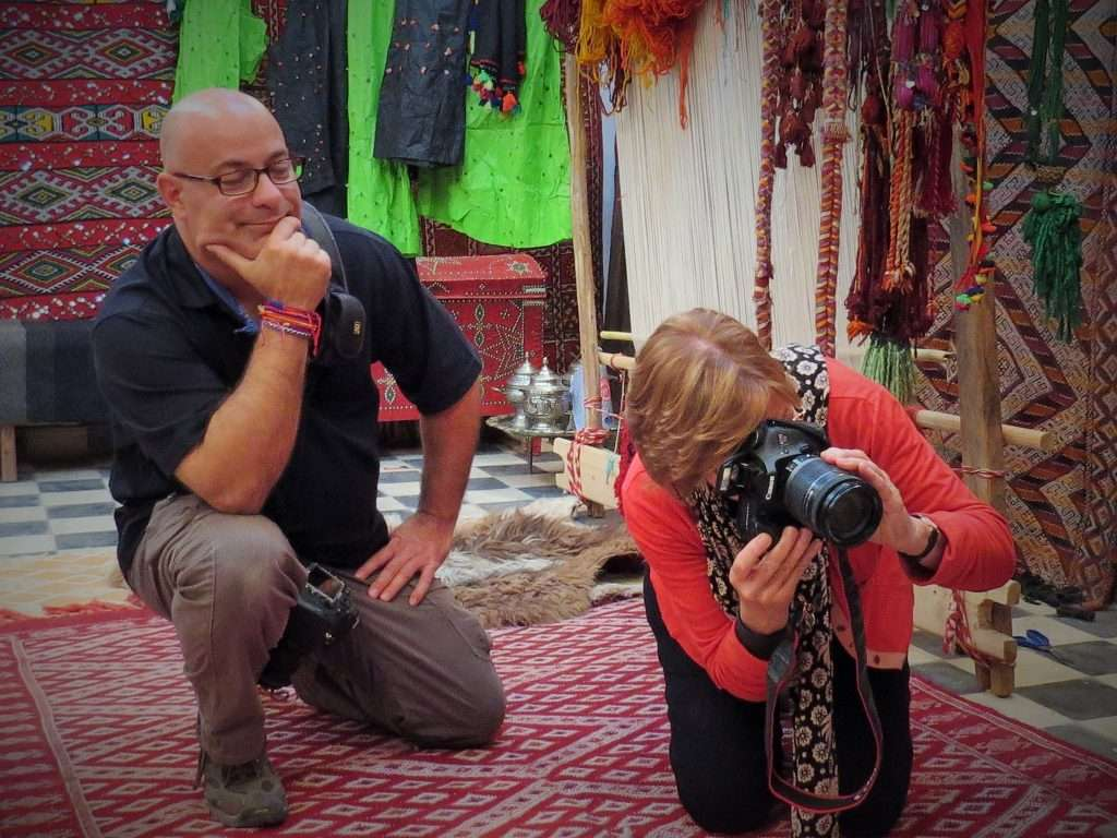 Travel photographer and photography instructor Ralph Velasco working with tour participant in Morocco.