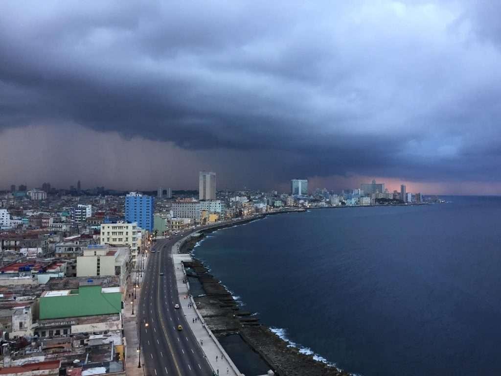Storm brewing on Malecon in Havana, Cuba by Ralph Velasco
