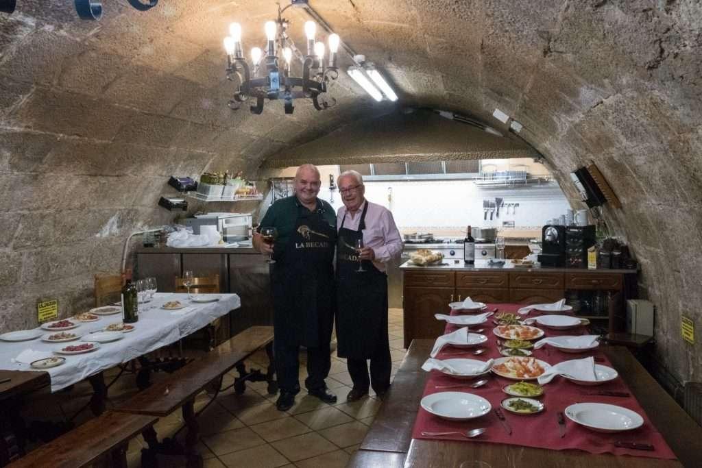 Two men at La Becada gastronomic society in Logroño, Spain by Ralph Velasco