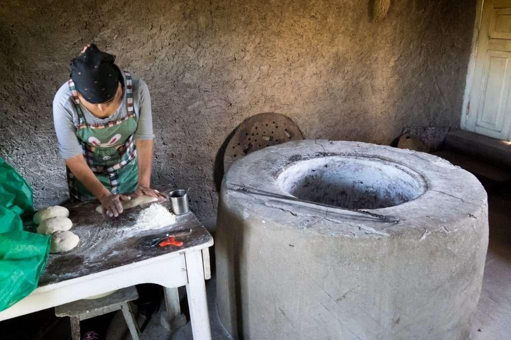 Woman Kneeding Dough with Tonir - Badiauri, Georgia by Ralph Velasco
