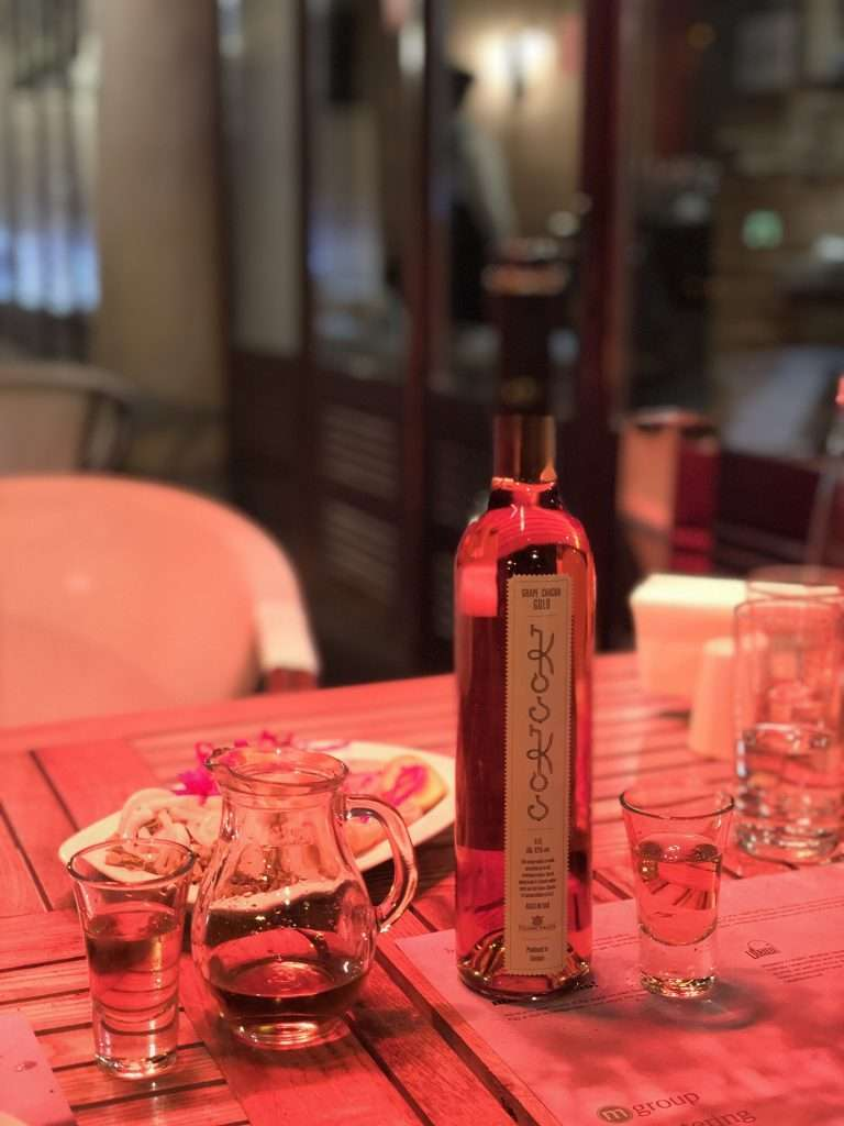 Bottle of chacha on table at Bread House restaurant in Tbilisi, Georgia by Ralph Velasco