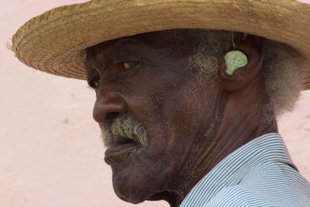 Man with a Coin in His Ear - Closeup - Trinidad, Cuba by Ralph Velasco
