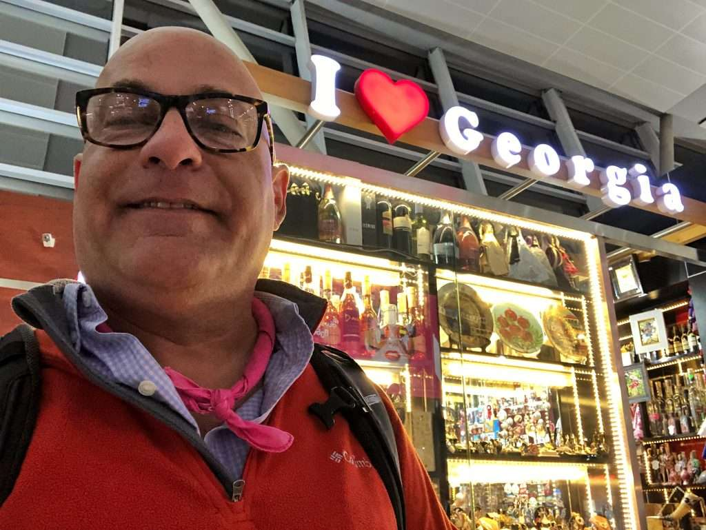 Ralph Velasco at TBS airport with I Love Georgia sign in Tbilisi, Georgia by Ralph Velasco