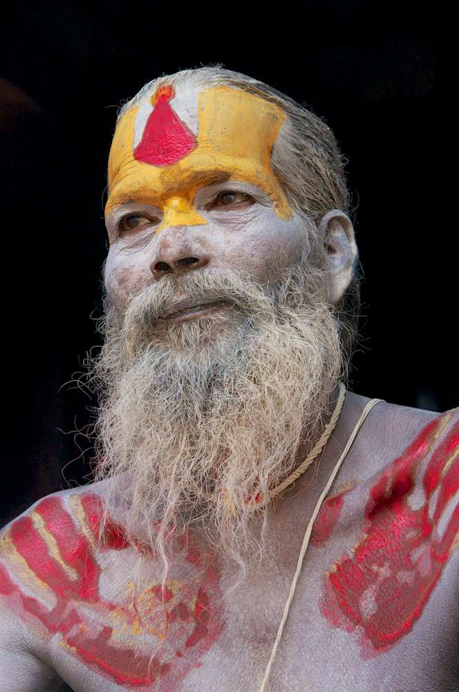 Portrait of sadhu in temple doorway in Pashupatinath, Nepal by Ralph Velasco